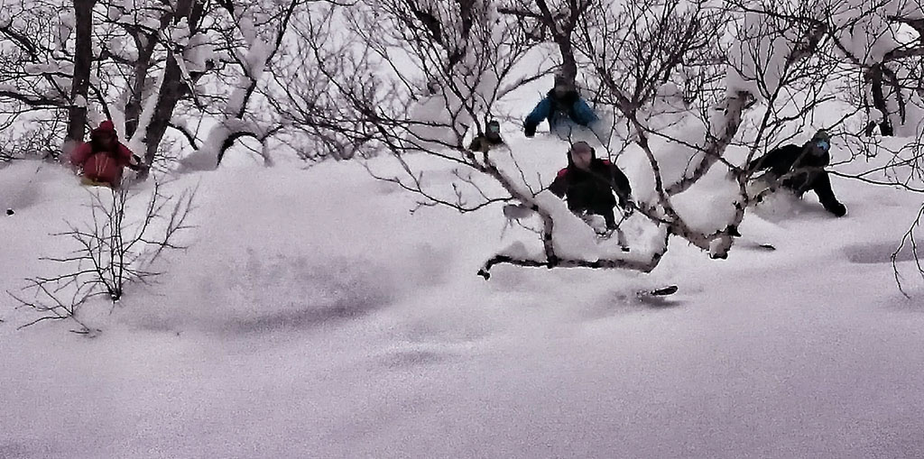 Our guide Rob getting arty with his photography while all 5 of the guys hit the pow hard